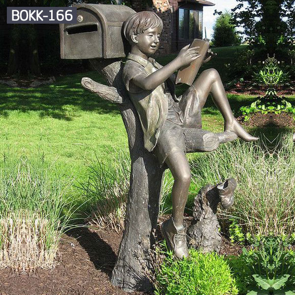 Bronze mailbox with little boy reading books outdoor decor