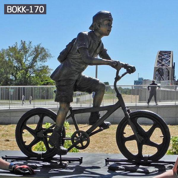 School boy ride on bicycle metal bronze outdoor sculptures for sale