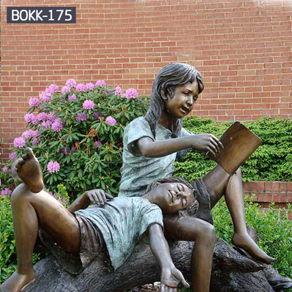 Girl is reading books for other girl bronze statues outdoor garden