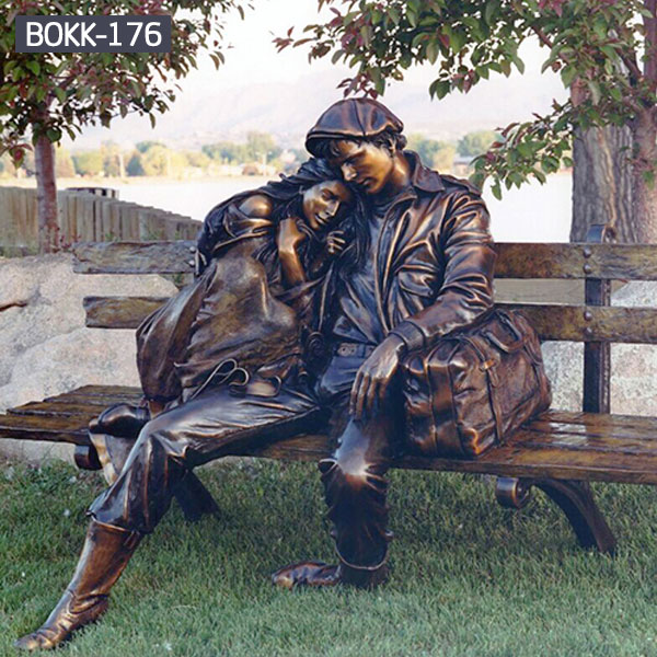 Young couples sitting on the park long benches outdoor bronze sculptures
