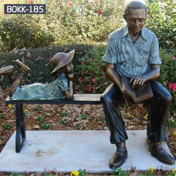 Grandpa is reading books on the benches for his little granddaughter bronze sculptures