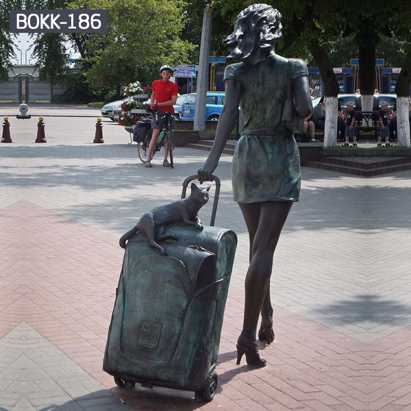 Modern city girl with suitcase and cat life size bronze sculptures