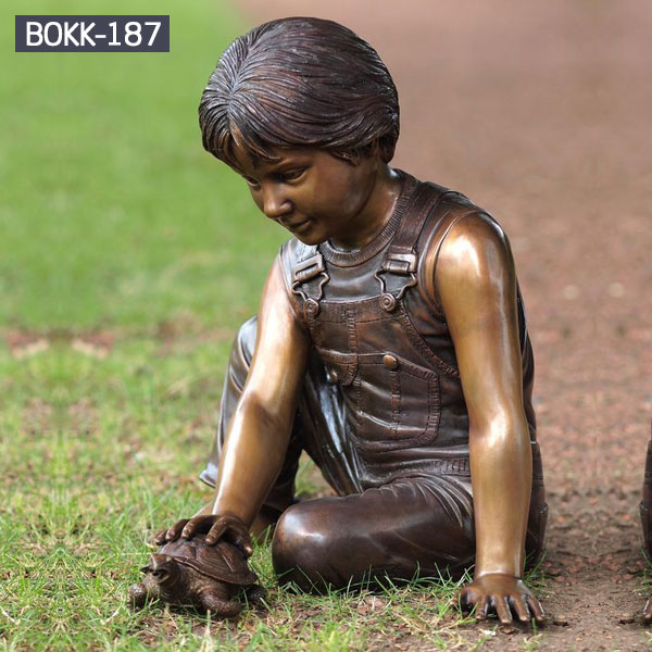 Bronze life size playing boy sitting on the lawn sculptures