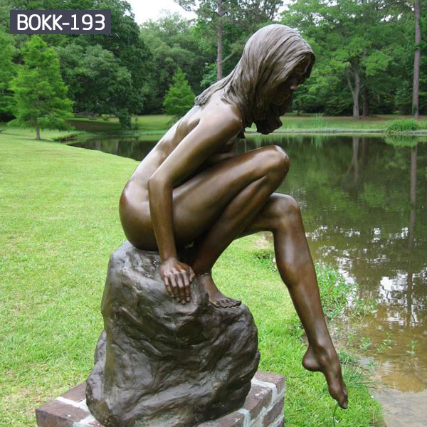 Life size nude woman bronze sculptures in the side of river outdoor