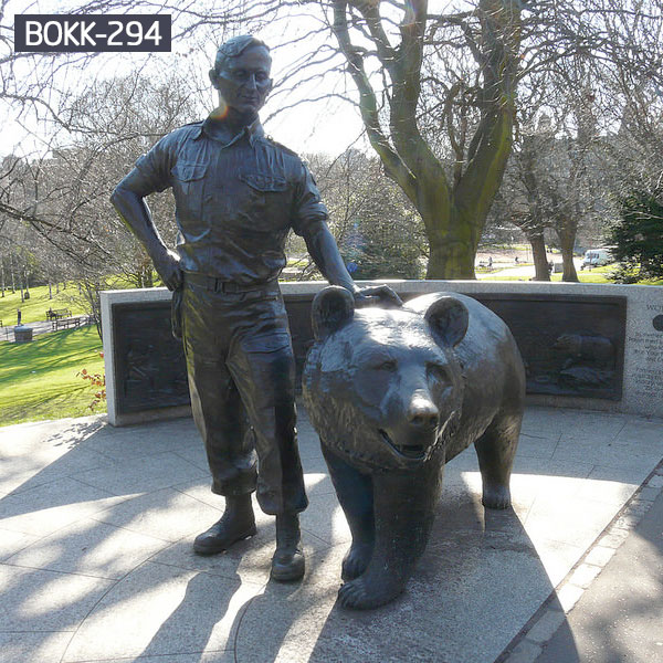 Human and giant grizzly bear statues outdoor garden