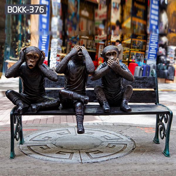 Modern street art bronze three monkey statues sitting on the bench for sale