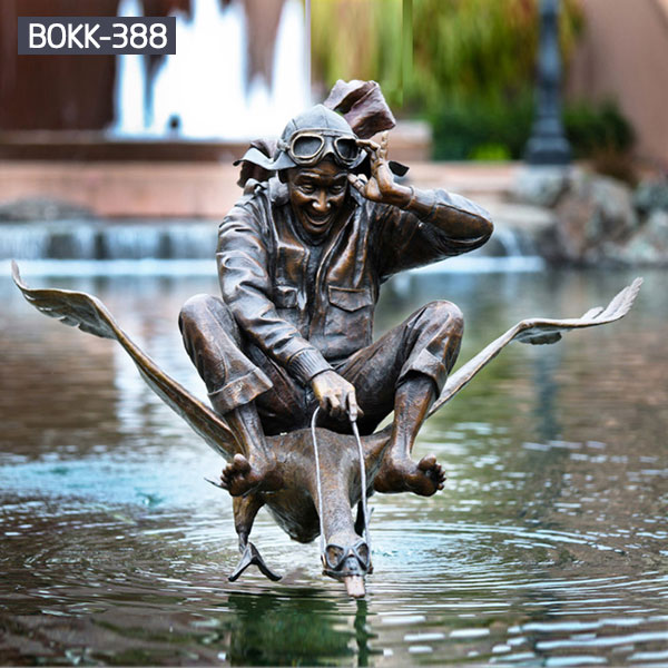 Outdoor bronze casting statues of man ride a crane for the pool decor